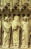 Sculpture on side of Notre Dam Stock Images