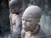 Sculpture of slaves in Stone Town, Zanzibar. Sculpture of slaves dedicated to victims of slavery in Stone Town of Zanzibar, placed close to the former slave royalty free stock photography