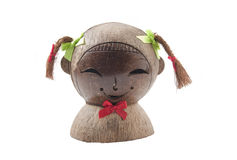 Sculpture of the smiling girls head. Made of coconut shell stock images