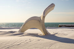 Sculpture on snow-covered promenade of Pomorie in Bulgaria, winter 2017 Stock Photos