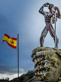 Sculpture Spanish mountaineer. Watching to top of the mountain Stock Image