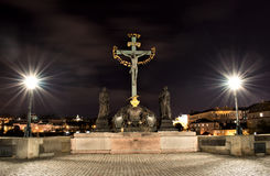 Sculpture of St. Cross Calvary. Night sculpture of the Holy Cross on Charles Bridge Royalty Free Stock Photos