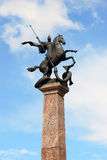 Sculpture of St. George on horseback, striking snake. NIZHNY NOVGOROD, RUSSIA - APRIL 23, 2015: View of sculpture of St. George on horseback, striking snake stock photos