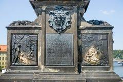 Sculpture of St. John of Nepomuk. On the Charles Bridge in Prague stock photography