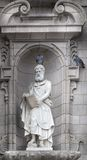 Sculpture of St. Matthew on the front facade of a cathedral, Cat Royalty Free Stock Photos