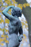 Sculpture of a standing girl Stock Image