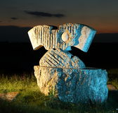 Sculpture of stone in colored light Royalty Free Stock Image