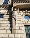 Sculpture of the strongman supporting the balcony of the Palace stock images