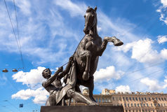 Sculpture tamer of horses. Designed by the Russian sculptor Baron Peter Klodt. Anichkov bridge, St. Petersburg, Russia, 1841 stock image