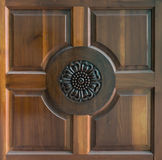 Sculpture on teak wood door. The picture of design sculpture on teak wood that popular in Thai style house door Stock Images