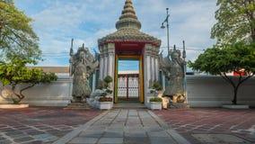 Sculpture Thaïlandais-chinoise en pierre en style et architecture thaïlandaise d'art dans le temple de Wat Phra Chetupon Vimolman Image libre de droits
