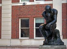 The Thinker at Columbia University. Sculpture of the Thinker in front of Philosophy Hall at Columbia University. Designed by Auguste Rodin Royalty Free Stock Photo