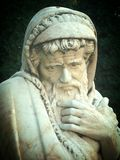 Sculpture of thinking Aristotle. A thoughtful philosopher with a beard in his cassock royalty free stock photo