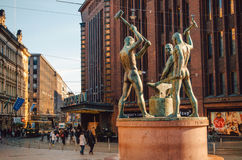 Sculpture Three Blacksmith, Helsinki, Finland. Helsinki, Finland - March 17, 2015: Monument Three Blacksmith in the center of tourist area Royalty Free Stock Photography