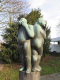 Sculpture of three naked men Stock Image