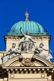 Sculpture of three women on facade of juliusz slowacki theater in cracow in poland Royalty Free Stock Images