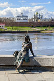 Sculpture of tired tourist girl (focus at the girl) in Veliky Novgorod Stock Image