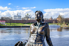Sculpture of tired tourist girl (focus at the girl) in Veliky Novgorod Royalty Free Stock Photos