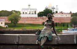 Sculpture of tired tourist near novgorod kremlin Stock Photos