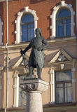 Sculpture of Torgils Knutsson on the background of the facade of a historic building. Vyborg, Leningrad region Stock Photos