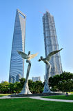 Sculpture and towers. Two angel sculpture with two Shanghais tallest building Royalty Free Stock Images