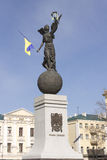 Sculpture on the town square in Kharkiv decorated with the flag. Of Ukraine. The inscription on the pedestal of Glory to Ukraine stock photography