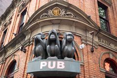 The Sculpture of Tree monkeys with different faces, No Speak, No See, No Hear on the gate of pub in Sydney stock image