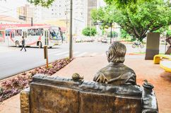 Sculpture in tribute to the poet Manoel de Barros on the sidewal. Campo Grande, Brazil - February 24, 2018: Sculpture in tribute to the poet Manoel de Barros on Royalty Free Stock Image