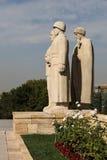 Sculpture turque en hommes située à l'entrée de la route de Lio Images stock