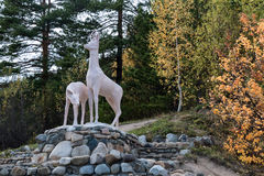 Sculpture of two deer on stones Royalty Free Stock Image