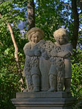 Sculpture of two kids with crown of flowers Stock Image