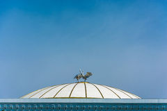 Sculpture of two storks on the domed roof Forums Palace in Tashk Royalty Free Stock Images