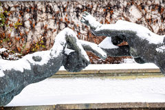 Sculpture of two women in the old city Park. Covered with snow. Winter sad picture Royalty Free Stock Image