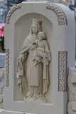 Sculpture of the Virgin Mary in a cemetery Royalty Free Stock Photos