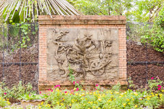 Sculpture on wall in tropical Thai garden. It is about Ramayana legend Stock Photography