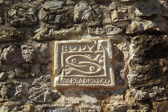 Sculpture on the wall, two fish - a symbol of Budva in Montenegro Royalty Free Stock Photos