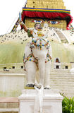 A sculpture of a warrior on the elephant protects the huge Boudhanath Stupa Stock Photo
