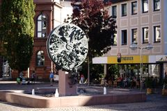 Sculpture Wheel of Fortune Worms. Worms, Germany - October 13, 2018: The sculpture Wheel of Fortune by the artist Gustav Nonnenmacher on the Upper Market on royalty free stock image