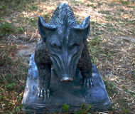 Sculpture of a wild boar on the ground. Close-up Royalty Free Stock Photography