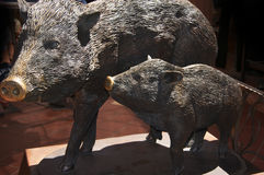 Sculpture of wild pigs, sow and piglet, in Sedona Arizona Stock Photos