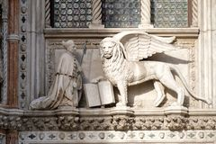 Sculpture of a winged lion, the heraldic symbol of the city of Venice in Italy. Old sculpture of a winged lion, the heraldic symbol of the city of Venice in stock image