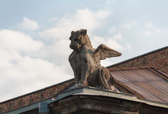 Sculpture of a winged lion on the roof of the building. Kiev Royalty Free Stock Photography