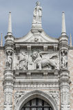 Sculpture of winged  lion of Venice with priest and book, Venice Royalty Free Stock Photography
