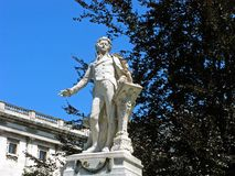 Sculpture of Wolfgang Amadeus Mozart. In Burggarten park. Austria, Vienna. Close-up. Sunny day and clear blue sky.n Royalty Free Stock Image
