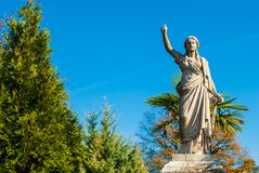 Sculpture of woman with anchor on Oakland Cemetery, Atlanta, USA. The sculpture of a woman with the anchor of hope on the Oakland Cemetery in sunny autumn day stock image