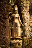 A sculpture of a woman in Angkor Wat, Siem Reap, Cambodia Royalty Free Stock Image