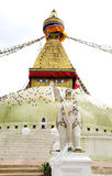A sculpture of woman on in front of Swayambhunath Stupa Royalty Free Stock Photography