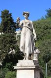 Sculpture of a woman with fruits and vegetables in the Piazza de. L PopoloPeople`s Square, Rome, Italy stock image