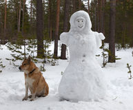 Sculpture of a woman made of snow in the forest park Royalty Free Stock Image