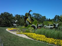 Sculpture of a woman in nature.. Botanical garden of Montreal Canada. royalty free stock photos